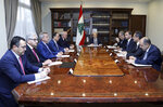 In this photo released by the Lebanese Government, Lebanese President Michel Aoun, center, meets with the country's top economic officials, at the Presidential Palace in Baabda, east of Beirut, Lebanon, Friday, Nov. 29, 2019. Friday's meeting is being attended by the ministers of economy and finance as well as Central Bank administrators and the head of the banking association. (Dalati Nohra/Lebanese Government via AP)