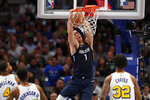 Dallas Mavericks forward Dwight Powell (7) dunks the ball as Golden State Warriors' Omari Spellman (4), Glenn Robinson III an Marquese Chriss (32) look on in the first half of an NBA basketball game in Dallas, Wednesday, Nov. 20, 2019. (AP Photo/Tony Gutierrez)