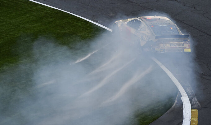 Daniel Hemric slides through the front stretch after a crash during the NASCAR All-Star Open auto race at Charlotte Motor Speedway in Concord, N.C., Saturday, May 18, 2019. (AP Photo/Mike McCarn)
