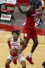 Wisconsin's Aleem Ford shoots past Nebraska's Lat Mayen during the second half of an NCAA college basketball game Tuesday, Dec. 22, 2020, in Madison, Wis. (AP Photo/Morry Gash)