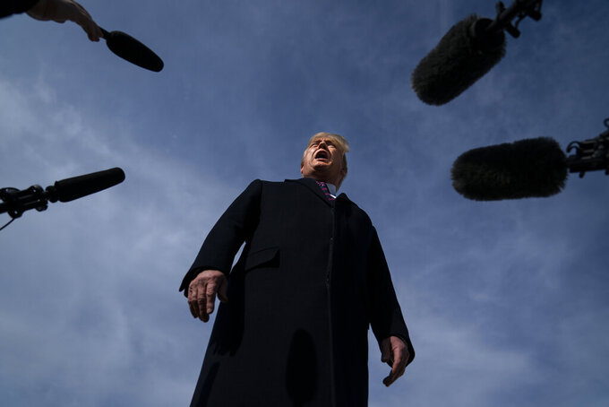 """FILE - In this Feb. 18, 2020, file photo President Donald Trump talks with reporters before boarding Air Force One for a trip to Los Angeles to attend a campaign fundraiser in Andrews Air Force Base, Md. In Trump's presidency, fact checking became a cottage industry unto itself. And """"alternative facts"""" became a buzzphrase, coined by one of his admiring aides. (AP Photo/Evan Vucci, File)"""