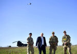 "Britain's Prime Minister Boris Johnson flies a Black Hornet nano drone as he meets with military personnel on Salisbury Plain training area near Salisbury, England, Thursday, Sept. 19, 2019. British Prime Minister Boris Johnson was accused by a one of the country's former leaders of a ""conspicuous"" failure to explain why he suspended Parliament for five weeks, as a landmark Brexit case at the U.K. Supreme Court came to a head on Thursday. (Ben Stansall/Pool Photo via AP)"