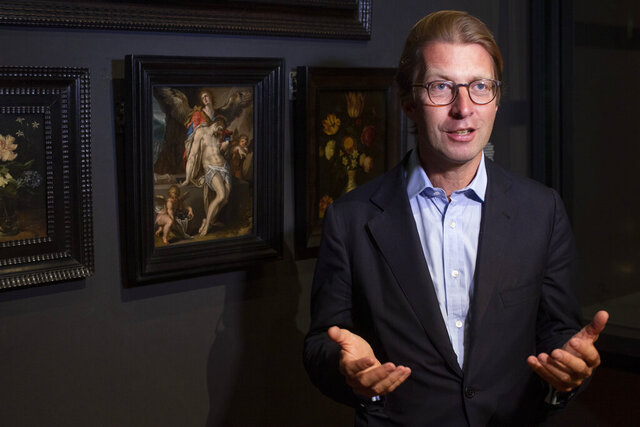 Rijksmuseum director Taco Dibbits, standing in front of Bartholomeus Spanger's