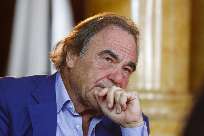 FILE - In this Aug. 15, 2017, file photo, Oliver Stone is shown during interview with Associated Press in Sarajevo, Bosnia. Oliver Stone has some memories to share, not all of them happy. Houghton Mifflin Harcourt announced Monday, July 15, 2019, that it had acquired a memoir by the Oscar-winning filmmaker. The book, currently untitled, is scheduled for Fall 2020. (AP Photo/Amel Emric, File)