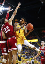 Michigan guard Charles Matthews (1) drives on Indiana forward Clifton Moore (22) in the second half of an NCAA college basketball game in Ann Arbor, Mich., Sunday, Jan. 6, 2019. (AP Photo/Paul Sancya)