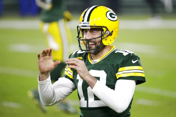 Green Bay Packers' Aaron Rodgers smiles as he warms up before an NFL football game against the Carolina Panthers Saturday, Dec. 19, 2020, in Green Bay, Wis. (AP Photo/Mike Roemer)