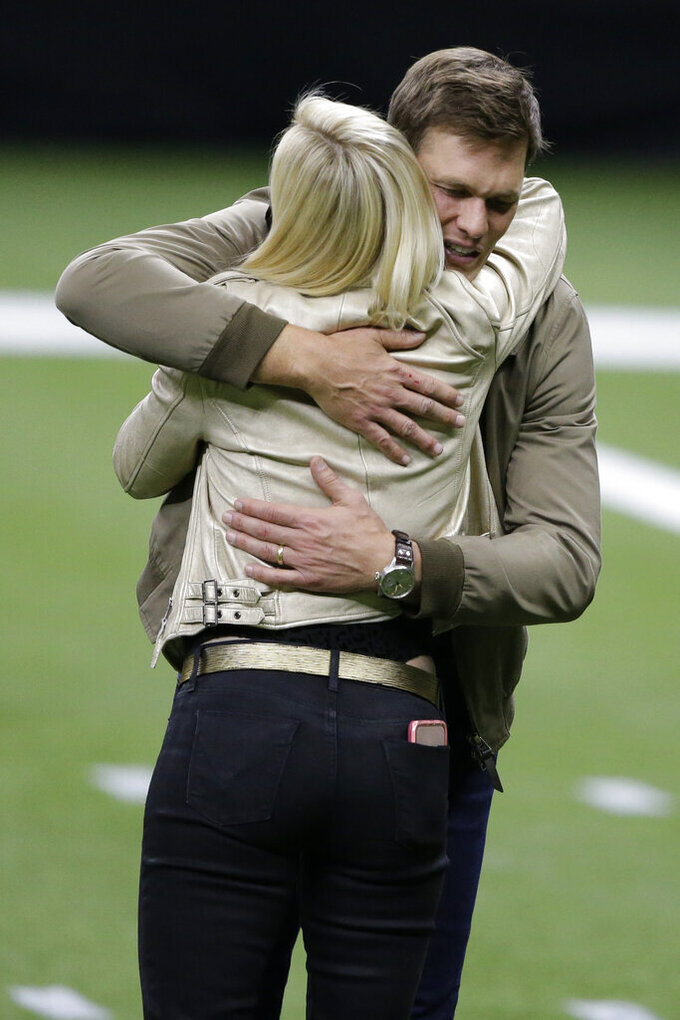 Tampa Bay Buccaneers quarterback Tom Brady embraces Brittany Brees after an NFL divisional round playoff football game between the New Orleans Saints and the Tampa Bay Buccaneers, Sunday, Jan. 17, 2021, in New Orleans. The Tampa Bay Buccaneers won 30-20. (AP Photo/Butch Dill)