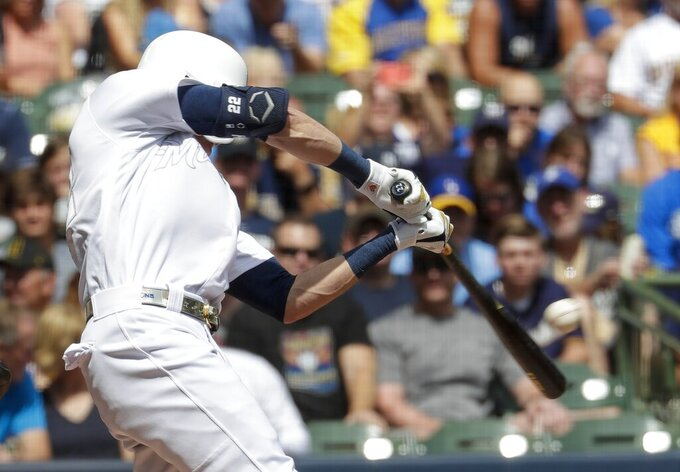 Milwaukee Brewers' Christian Yelich hits a single during the first inning of a baseball game against the Arizona Diamondbacks Sunday, Aug. 25, 2019, in Milwaukee. (AP Photo/Morry Gash)