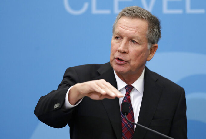 FILE - In this Dec. 4, 2018, file photo, then-Ohio Gov. John Kasich speaks at The City Club of Cleveland, in Cleveland. Ohio Republicans are trying to rally and present a united front heading into their party's national convention, following a week when Kasich, one of their best-known politicians, spoke on behalf of Joe Biden to the Democrats' convention. (AP Photo/Tony Dejak, File)