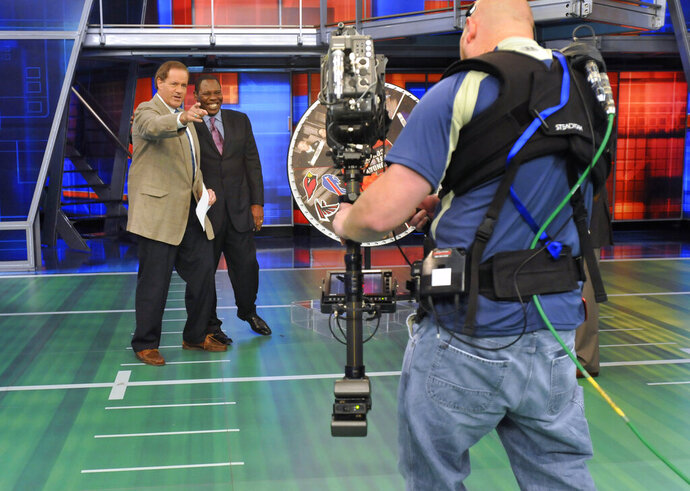 "FILE - In this Oct. 26, 2008, file photo, Chris Berman, left, gestures during a live segment of Sunday NFL Countdown with colleague Tom Jackson at ESPN in Bristol, Conn. ""NFL PrimeTime"" with Berman and Jackson is coming back after a 14-year absence. ESPN+ is bringing back the popular highlights show beginning Sunday, Sept. 15, 2019. (AP Photo/Jessica Hill, File)"