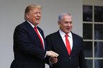 President Donald Trump welcomes visiting Israeli Prime Minister Benjamin Netanyahu to the White House in Washington, Monday, March 25, 2019. (AP Photo/Manuel Balce Ceneta) Presiden