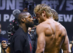 Floyd Mayweather, left, and Logan Paul pose for photographers during a weigh-in Saturday, June 5, 2021, in Hollywood, Fla. Paul is scheduled to face Mayweather in an exhibition boxing match at Hard Rock Stadium in Miami Gardens, Fla., Sunday. (AP Photo/Jim Rassol)