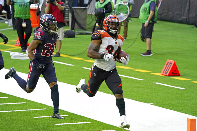 Cincinnati Bengals running back Samaje Perine (34) rushes for a touchdown as Houston Texans cornerback Vernon Hargreaves III (26) defends during the second half of an NFL football game Sunday, Dec. 27, 2020, in Houston. (AP Photo/Sam Craft)