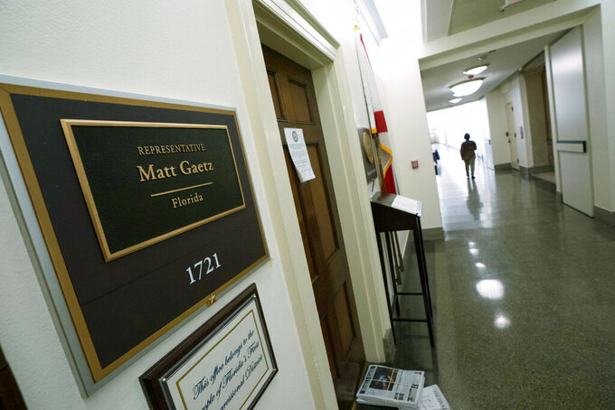 People pass by the Rep. Matt Gaetz, R-Fla., office on Capitol Hill, in Washington, Tuesday, April 13, 2021. The House Ethics Committee has opened an investigation of Rep. Gaetz, citing reports of sexual and other misconduct by the Florida Republican. (AP Photo/Jose Luis Magana)