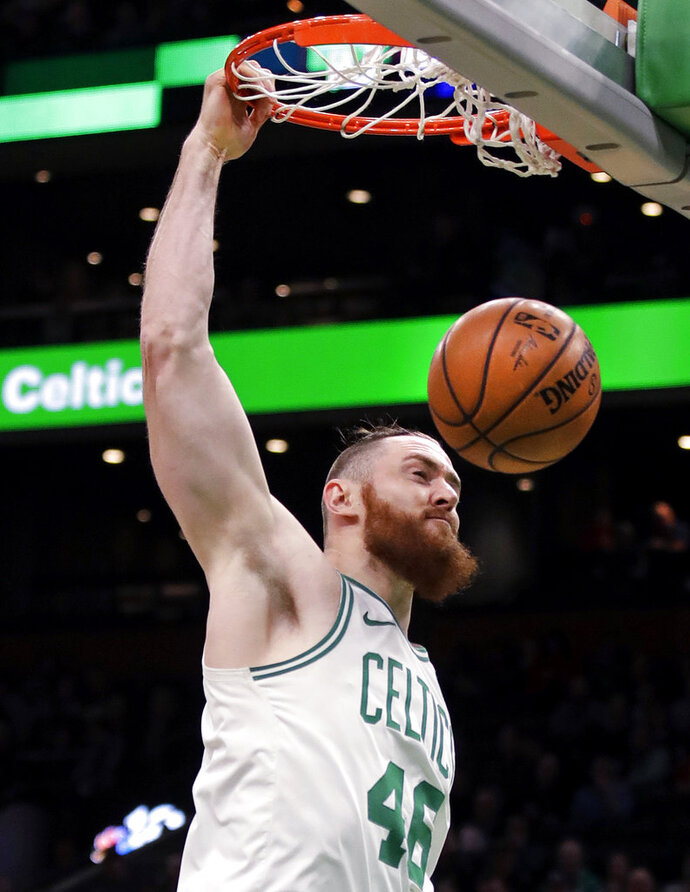 Boston Celtics center Aron Baynes (46) slams a dunk during the first quarter of a basketball game against the Phoenix Suns in Boston, Wednesday, Dec. 19, 2018. (AP Photo/Charles Krupa)