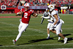 Nebraska quarterback Adrian Martinez (2) scores a touchdown in front of Minnesota defensive back Jacob Huff (2) and linebacker Carter Coughlin (45) during the first half of an NCAA college football game in Lincoln, Neb., Saturday, Oct. 20, 2018. (AP Photo/Nati Harnik)