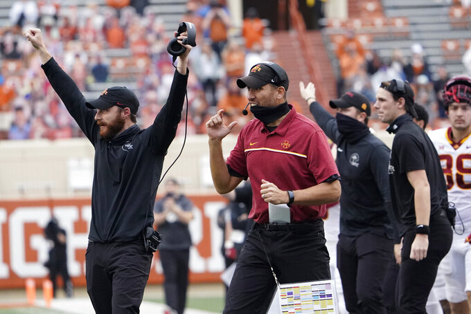 FILE - Iowa State head coach Matt Campbell, center, reacts with other team mambers during the second half of an NCAA college football game against Texas in Austin, Texas, in this Friday, Nov. 27, 2020, file photo. The Cyclones, who at No. 8 have their highest ranking ever in The Associated Press poll, play No. 12 Oklahoma on Saturday, Dec. 19, 2020, at AT&T Stadium in Arlington, Texas. (AP Photo/Eric Gay, File)