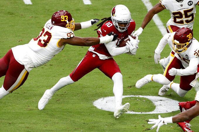 Arizona Cardinals wide receiver DeAndre Hopkins (10) makes a catch as Washington Football Team defensive tackle Jonathan Allen (93) pursues during the first half of an NFL football game, Sunday, Sept. 20, 2020, in Glendale, Ariz. (AP Photo/Darryl Webb)