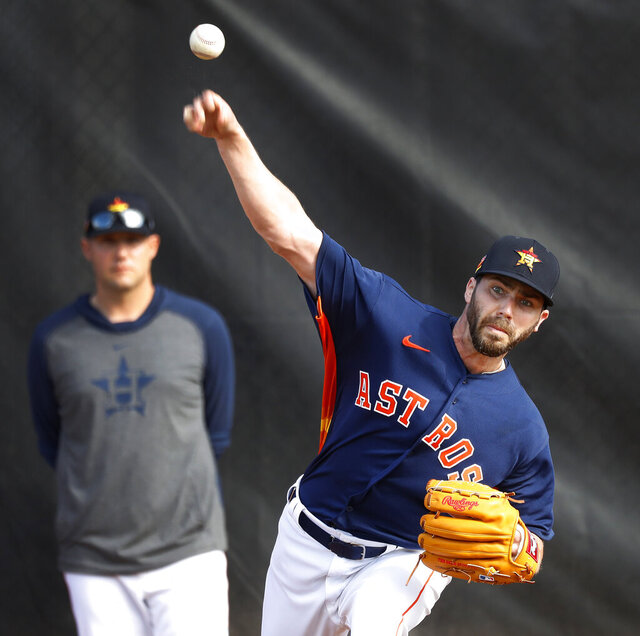 Houston Astros pitcher Austin Pruitt (51) warms up before pitching live batting practice during baseball spring training Wednesday, Feb. 19, 2020, in West Palm Beach, Fla. (Karen Warren/Houston Chronicle via AP)