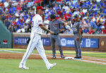 Texas Rangers pitcher Jesse Chavez (53) exits the game after giving up six runs in the first inning of a baseball game against the Arizona Diamondbacks Wednesday, July 17, 2019, in Arlington, Texas. (AP Photo/Richard W. Rodriguez)