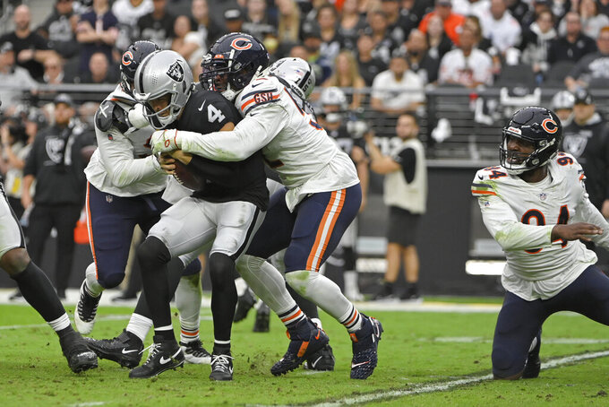Chicago Bears outside linebacker Khalil Mack (52) sacks Las Vegas Raiders quarterback Derek Carr (4) during the first half of an NFL football game, Sunday, Oct. 10, 2021, in Las Vegas. (AP Photo/David Becker)