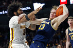 Michigan's Ignas Brazdeikis, front right, tries to keep Minnesota's Jordan Murphy away from the ball in the first half of an NCAA college basketball game Thursday, Feb. 21, 2019, in Minneapolis. (AP Photo/Jim Mone)