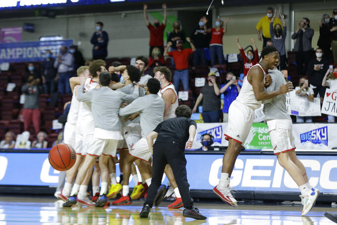 Eastern Washington players celebrate a 65-55 win over Montana State during an NCAA college basketball game for the championship of the Big Sky men's tournament in Boise, Idaho, Saturday, March 13, 2021. (AP Photo/Otto Kitsinger)