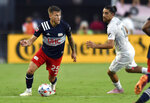 New England Revolution midfielder Arnor Ingvi Traustason (25) looks to pass the ball as Inter Miami midfielder Rodolfo Pizarro (10) defends during the first half of an MLS soccer match Wednesday, July 21, 2021, in Fort Lauderdale, Fla. (AP Photo/Jim Rassol)