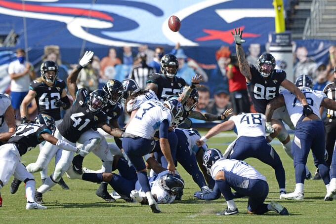 Tennessee Titans kicker Stephen Gostkowski (3) kicks a 49-yard field goal against the Jacksonville Jaguars in the fourth quarter of an NFL football game Sunday, Sept. 20, 2020, in Nashville, Tenn. The kick gave the Titans a 33-30 win. (AP Photo/Mark Zaleski)