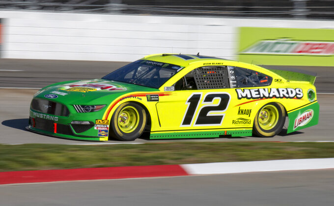 Ryan Blaney races for position during qualifying for the NASCAR Monster Energy Cup Series race at Martinsville Speedway in Martinsville, Va., Saturday, March 23, 2019. (AP Photo/Matt Bell)