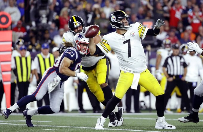 Pittsburgh Steelers quarterback Ben Roethlisberger (7) passes under pressure from New England Patriots defensive end Chase Winovich, left, in the first half an NFL football game, Sunday, Sept. 8, 2019, in Foxborough, Mass. (AP Photo/Elise Amendola)