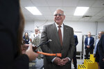 Minnesota Gov. Tim Walz tours Minnesota based Phillips & Temro in Eden Prairie, Minn. Monday, July 26, 2021. Minnesota  became the first Midwestern state to adopt a plan for encouraging the switchover to electric vehicles, as Gov. Walz predicted that someday people will wonder why there was such as fuss. (Glen Stubbe/Star Tribune via AP)