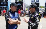 Crew chief Chad Knaus, left, talks with former teammate Jimmie Johnson before practice for a NASCAR cup series auto race at Michigan International Speedway, Friday, June 7, 2019, in Brooklyn, Mich. (AP Photo/Carlos Osorio)