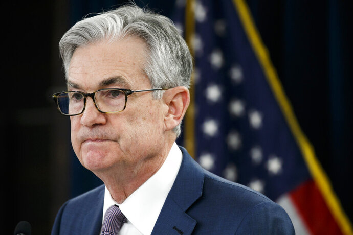 FILE - In this Tuesday, March 3, 2020 file photo, Federal Reserve Chair Jerome Powell pauses during a news conference to discuss an announcement from the Federal Open Market Committee, in Washington.   The Federal Reserve says it will keep buying bonds, Wednesday, June 10,  to maintain low borrowing rates and support the U.S. economy in the midst of a recession. And it says nearly all the Fed's policymakers foresee no rate hike through 2022. .(AP Photo/Jacquelyn Martin, File)