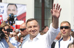 FILE - In this Wednesday, June 17, 2020 file photo, Polish President Andrzej Duda waves to supporters as he campaigns for a second term in Serock, Poland. Polands current President Andrzej Duda is the frontrunner ahead of the election on Sunday, June 28, but polls show him unlikely to achieve the majority needed to win outright. That will require a runoff two weeks later in which he is expected to face off against Warsaw Mayor Rafal Trzaskowski in a very close race. (AP Photo/Czarek Sokolowski, file)