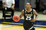 FILE - In this Feb. 13, 2021, file photo, Colorado guard McKinley Wright IV (25) dribbles against California during the second half of an NCAA basketball game in Berkeley, Calif. Wright is a member of The AP All-Pac 12 first team, announced Tuesday, March 9, 2021. (AP Photo/John Hefti, File)