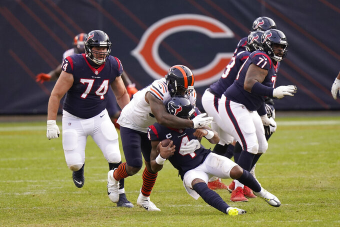 Houston Texans' Deshaun Watson (4) is sacked by Chicago Bears' Mario Edwards (97) during the second half of an NFL football game, Sunday, Dec. 13, 2020, in Chicago. (AP Photo/Nam Y. Huh)