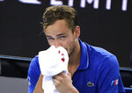 Russia's Daniil Medvedev holds a towel on his nosebleed during his second round singles match against Spain's Pedro Martinez at the Australian Open tennis championship in Melbourne, Australia, Thursday, Jan. 23, 2020. (AP Photo/Andy Brownbill)