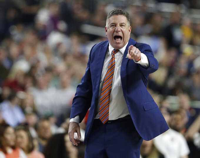 Auburn head coach Bruce Pearl directs his team during the second half against Virginia in the semifinals of the Final Four NCAA college basketball tournament, Saturday, April 6, 2019, in Minneapolis. (AP Photo/David J. Phillip)