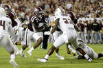 Texas A&M running back Jashaun Corbin (7) rushes for a touchdown against Texas State during the first half of an NCAA college football game, Thursday, Aug. 29, 2019, in College Station, Texas. (AP Photo/Sam Craft)