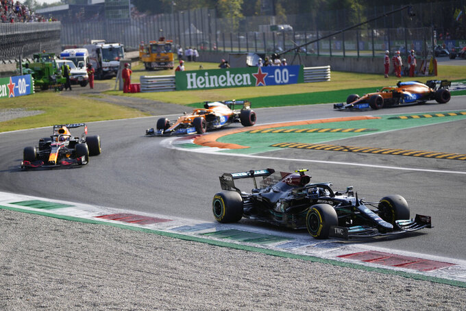 Mercedes driver Valtteri Bottas of Finland leads Red Bull driver Max Verstappen of the Netherlands and the two McLaren during the Sprint Race qualifying session at the Monza racetrack, in Monza, Italy , Saturday, Sept.11, 2021. The Formula one race will be held on Sunday. (AP Photo/Antonio Calanni)