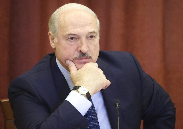 Belarusian President Alexander Lukashenko attends a meeting as he visits Belarusian Academy of Sciences in Minsk, Belarus, Friday, Sept. 11, 2020. (Nikolai Petrov/BelTA Pool Photo via AP)