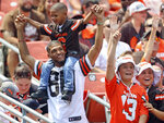 Cleveland Browns fans watch an Orange and Brown NFL football practice in Cleveland, Sunday, Aug. 8, 2021. (Joshua Gunter/The Plain Dealer via AP)