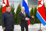 Russian President Vladimir Putin, right, welcomes North Korea's leader Kim Jong Un for the talks in Vladivostok, Russia, Thursday, April 25, 2019. Putin and Kim are set to have one-on-one meeting at the Far Eastern State University on the Russky Island across a bridge from Vladivostok. The meeting will be followed by broader talks involving officials from both sides. (AP Photo/Alexander Zemlianichenko, Pool)