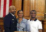 Assistant Chief Michael Brunson poses for a picture with his wife and one of his two sons after was sworn-in Friday, Aug. 7, 2020, in Milwaukee, as acting Milwaukee police chief. On Thursday, the commission voted to demote Milwaukee Police Chief Alfonso Morales to the rank of captain. (Rick Wood/Milwaukee Journal-Sentinel via AP)