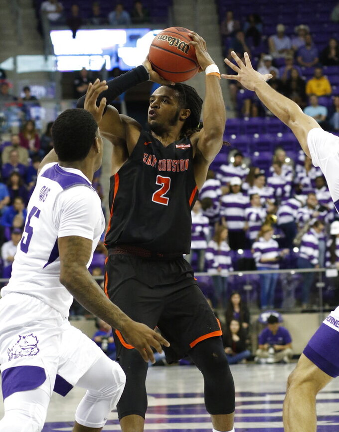 TCU guard Kendric Davis (5) defends against Sam Houston State guard Cameron Delaney (2) during the first half of an NCAA college basketball game in the NIT on Wednesday, March 20, 2019, in Fort Worth, Texas. (David Kent/Star-Telegram via AP)