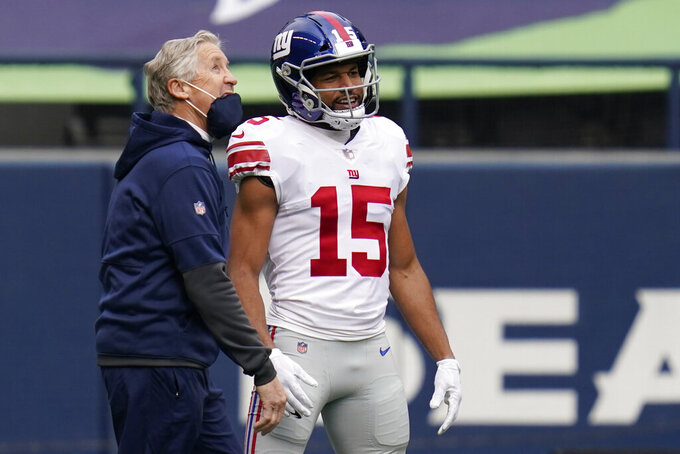 Seattle Seahawks head coach Pete Carroll talks with New York Giants wide receiver Golden Tate (15) before an NFL football game, Sunday, Dec. 6, 2020, in Seattle. (AP Photo/Elaine Thompson)