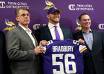 Minnesota Vikings first-round draft pick Garrett Bradbury, center, holds his jersey next to general manager Rick Spielman, left, and head coach Mike Zimmer during an NFL football news conference in Eagan, Minn., Friday, April 26, 2019. (Renee Jones Schneider/Star Tribune via AP)