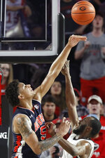 Auburn forward Chuma Okeke (5) blocks a shot from Georgia guard William Jackson II during an NCAA college basketball game Wednesday, Feb. 27, 2019, in Athens, Ga. (Joshua L. Jones/Athens Banner-Herald via AP)