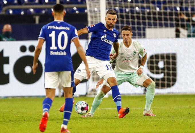 Schalke's Vedad Ibisevic controls the ball during the German Bundesliga soccer match between FC Schalke 04 and Werder Bremen in Gelsenkirchen, Germany, Saturday, Sept. 26, 2020. (AP Photo/Martin Meissner)